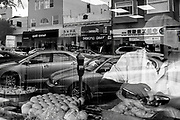 Fine Art: 2014 San Francisco, CA: A baker works in the window of his shop with reflections of his view outside.