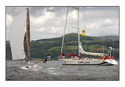 The 2004 Skiff Nationals at Largs held by the SSI.<br /> <br /> Andy Richards, Andy Fairlie and Dave Richards onboard Radii, with sponsors onboard Drum<br /> <br /> Marc Turner / PFM Pictures
