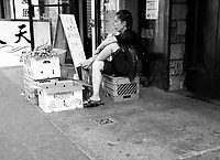 A fruit vendor in China Town, New York City