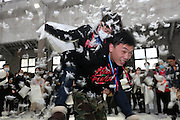 NANTONG, CHINA - DECEMBER 20: (CHINA OUT) <br /> <br /> Young People Enjoy Pillow Fight To Release Pressure<br /> <br /> Young people enjoy pillow fight at an old factory on December 20, 2015 in Nantong, Jiangsu Province of China. Young people used pillows fight with each other to release pressure at the Reply Culture space in an old factory ahead of Christmas in Nantong. <br /> ©Exclusivepix Media