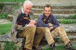 Christopher Lloyd and Fergus Garratt with Dahlia and Canna on the circular steps at Dixter