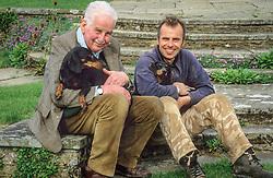 Christopher Lloyd and Fergus Garratt with Dahlia and Canna on the circular steps at Dixter