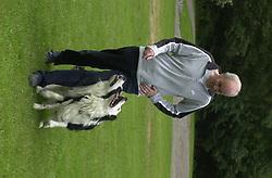 Eddie Sander with his Dogs Jackson and Inka<br /><br />18 June 2004<br /><br />Copyright Paul David Drabble<br /> [#Beginning of Shooting Data Section]<br />Nikon D1 <br /> Focal Length: 80mm<br /> Optimize Image: <br /> Color Mode: <br /> Noise Reduction: <br /> 2004/06/18 09:40:11.4<br /> Exposure Mode: Manual<br /> White Balance: Auto<br /> Tone Comp: Normal<br /> JPEG (8-bit) Fine<br /> Metering Mode: Center-Weighted<br /> AF Mode: AF-S<br /> Hue Adjustment: <br /> Image Size:  2000 x 1312<br /> 1/200 sec - F/7.1<br /> Flash Sync Mode: Not Attached<br /> Saturation: <br /> Color<br /> Exposure Comp.: 0 EV<br /> Sharpening: Normal<br /> Lens: 80-200mm F/2.8<br /> Sensitivity: ISO 200<br /> Image Comment: <br /> [#End of Shooting Data Section]