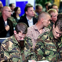 Nederland, Doorn , 26 septembre 2013.<br /> Veteranendag op militaire basis in Doorn.<br /> Karl Marlantes (r), Vietnam veteraan en schrijver ontmoet Nederlandse veteranen van de oorlog in Afghanistan. <br /> Veterans day at militairy base in Doorn.<br /> KarlMarlantes Vietnam veteran and writer meets veterans de la guerre d'Afghanistan.<br /> Karl Marlantes right (born December 24, 1944) is an American author, businessman, and decorated Marine veteran.<br /> He is the author of Matterhorn: A Novel of the Vietnam War<br /> Dutch veterans in the audience.<br /> Foto:Jean-Pierre Jans
