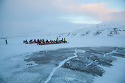 UNIS students regroup in Adventdalen, Svalbard on a class field trip by snowmobile to Rabotbreen.