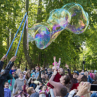 Participants blow soap bubbles during a soap bubble flashmob in a public park in Budapest, Hungary on May 17, 2019. ATTILA VOLGYI
