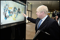 The London Mayor Boris Johnson signs in the visitors book as HE tours Masdar City and meets Sultan Al Jaber, CEO of Masdar and Minister of State for Energy. The Mayor is on a 2 day tour of the UAE, Monday April 15, 2013. Photo By Andrew Parsons / i-Images