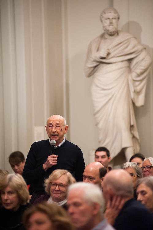 An audience member of a Boston Athenaeum event addresses the panel.