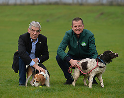 CEO of the Edinburgh Dog and Cat Home Howard Bridges (left) and runner Dion Leonard (right) chat whilst taking dogs Louis and Lexi for a walk after Dion donated almost £6500 GBP he raised after running three extreme races in the US to the Edinburgh charity.<br /> <br /> © Dave Johnston / EEm