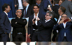 Tennis player Rafael Nadal (centre) in the stands during the UEFA Europa League, Semi Final, Second Leg at Wanda Metropolitano, Madrid.