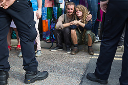 London, UK. 3 September, 2019. Activists sit alongside an access road to ExCel London in solidarity with Quakers being arrested for blocking access to DSEI, the world's largest arms fair, during the second day of week-long protests. Protests were themed around faith and prayer and involved believers deriving from multiple faiths including the Quakers standing in solidarity against arms sales.