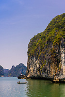 Halong Bay, North Vietnam. The bay features 3,000  limestone and dolomite karsts and islets in various shapes and sizes sprinkled over 1,500 square kilometers. It offers a wonderland of karst topography. It is a UNESCO World Heritage Site.