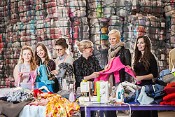 Students Emam McDowall, Lucu Morrant, Hannah McKinnon, Scottish fashion designer Niki Taylor, Model Anna Freemantle, and student Allison Radcliffe. Showing fashion students about upcycling clothes, at the UK's second largest textile recycling facility, Nathan's Wastesavers, in Denny.<br /> © Michael Schofield.