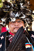A Native American dancer from the Arapahoe people dressed in traditional costume at the Indian Village during Cheyenne Frontier Days July 25, 2015 in Cheyenne, Wyoming. Frontier Days celebrates the cowboy traditions of the west with a rodeo, parade and fair.