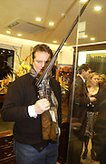 Matthew Hockley-Smith, Charles Finch and Dr. Franco Beretta host launch of Beretta stor at 36 St. James St. London. 10  January 2006. ONE TIME USE ONLY - DO NOT ARCHIVE  © Copyright Photograph by Dafydd Jones 66 Stockwell Park Rd. London SW9 0DA Tel 020 7733 0108 www.dafjones.com