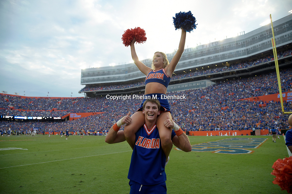 Florida cheerleaders celebrate after an NCAA college football game against Tennessee Saturday, Sept. 16, 2017, in Gainesville, Fla. Florida won 26-20. (Photo by Phelan M. Ebenhack)