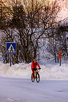 Bicycling in winter, Svolvaer, on Austvagoya Island, Lofoten Islands, Arctic, Northern Norway.