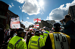 "© London News Pictures. 07/09/2013. London, UK.  Members of the EDL (English Defence League) March in the Borough of Tower Hamlets in East London on September 7, 2013. The group claim that the area is ""subject to Sharia law"".  Photo credit: Ben Cawthra/LNP"