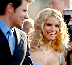 Cast member Jessica Simpson and her husband Nick Lachey attend the premiere of Warner Bros 'The Dukes of Hazzard', also starring Burt Reynolds, Seann William Scott, Johnny Knoxville and Lynda Carter, held at the Grauman's Chinese Theatre in Los Angeles, CA, USA, on July 28, 2005. Photo by Lionel Hahn/ABACAPRESS.COM.  | 81843_04 Los Angeles