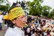 04 AUGUST 2013 - BANGKOK, THAILAND: An anti-government protester with a head band supporting Bhumibol Adulyadej, the King of Thailand, during a rally in Bangkok. The protesters are strong supporters of the Thai monarchy. About 2,000 people, members of the  People's Army against Thaksin Regime, a new anti-government group, protested in Lumpini Park in central Bangkok. The protest was peaceful but more militant protests are expected later in the week when the Parliament is expected to debate an amnesty bill which could allow Thaksin Shinawatra, the exiled former Prime Minister, to return to Thailand.      PHOTO BY JACK KURTZ