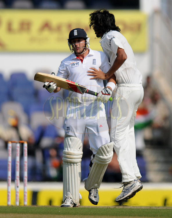 Ishant Sharma of India collides with Tim Bresnan of England as he celebrates the wicket of latter during day two of the 4th Airtel Test Match between India and England held at VCA ground in Nagpur on the 14th December 2012..Photo by  Pal Pillai/BCCI/SPORTZPICS .