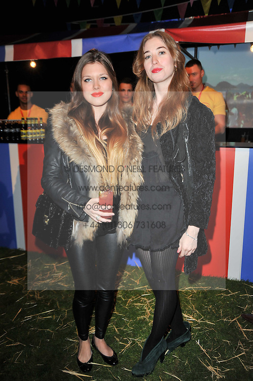 Left to right, REBECCA HOFFNUNG and ANOUSHKA GERHAUSER at a party to celebrate the global launch of the Iconic Brazilian lifestyle brand Havaianas Wellies range held at Selfridges, Oxford Street, London on 14th April 2011.