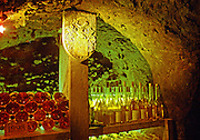 The Oremus winery in Tolcsva, Tokaj: bottles lying in the underground cellar, backlit, giving a wonderful, magical golden-reddish glow. Waiting to mature. Standing bottles ready to be tasted in the underground tasting room. Oremus is owned by the Alvarez family that also owns Vega Sicilia in Spain It is managed by Andras Bacso. Credit Per Karlsson BKWine.com