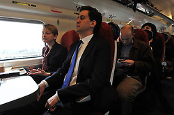 © Licensed to London News Pictures. 16/03/2012. London, UK. Ed Miliband sits next to Yvette Cooper. Leader of the Labour Party, Ed Miliband and members of his Shadow Cabinet travel to Labour's Youth Conference in Coventry this morning, 16 March 2012, by train from London Euston Station. Photo credit : Stephen SImpson/LNP