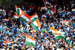 India fans wave flags in the stands during the ICC Cricket World Cup group stage match at Edgbaston, Birmingham.