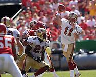 San Francisco quarterback Alex Smith (11) throws down field against Kansas City at Arrowhead Stadium in Kansas City, Missouri October 1, 2006.  The Chiefs beat the 49ers 41-0.