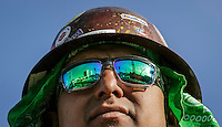 The job site is reflected the safety glasses of Miguel Chavarria at the construction site in West Hollywood of a new 190-room hotel being built by Charles Pankow Builders Ltd. Jan. 31, 2017.  Photo by David Sprague