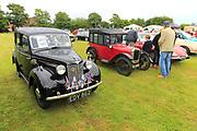 Historic classic vintage vehicles at summer fete car rally, Alderton, Suffolk, England, UK
