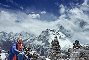 """On a 1981 trek in the Mount Everest area, Tom Dempsey pauses for a self portrait at 15,400 feet elevation on the terminal moraine of the Khumbu Glacier across from Taweche Peak, Nepal, Asia. A row of stone monuments were built near here in memory of six Sherpas who were killed in an avalanche during the 1970 Japanese expedition to film """"The Man Who Skied Down Everest."""" Sagarmatha National Park is honored by UNESCO as a World Heritage Site."""