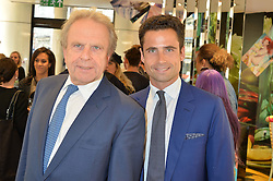 Left to right, MARK FENWICK chairman of Fenwick and his son LEO FENWICK at the Miles of MAC Fenwick Launch at Fenwick, 63 New Bond Street, London on 11th June 2015.