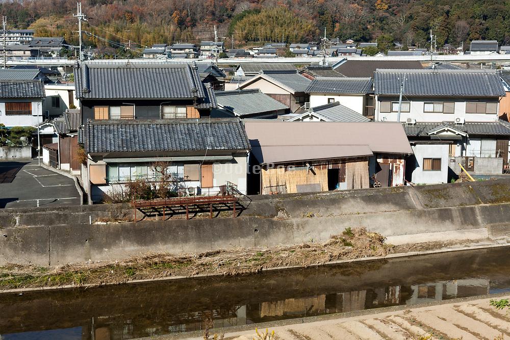 flood protection canal and housing in Sakurai, Nara prefecture Japan