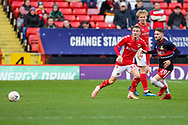 Charlton Athletic midfielder Taylor Maloney (36) and Doncaster Rovers defender Shaun Cummings (29) during the The FA Cup 2nd round match between Charlton Athletic and Doncaster Rovers at The Valley, London, England on 1 December 2018. Photo by Toyin Oshodi