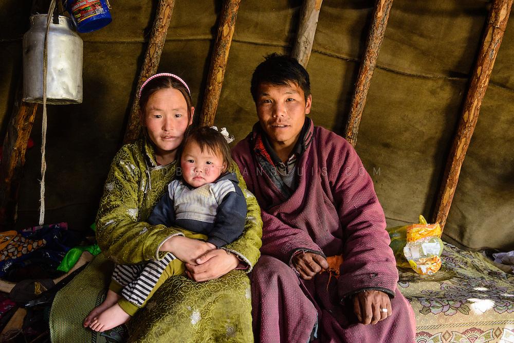 Family of Dukha (Tsaatan) reindeer herders in their ortz (teepee). Approximately 200 families comprise the Tsaatan or Dukha community in northwestern Mongolia, whose existence is intimately linked to their herds of reindeer. Photo © Robert van Sluis