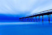 Wrightsville Beach's Oceanic Pier is silhouetted by morning's light along the North Carolina coast.<br /> Photos By Jeff Janowski Photography