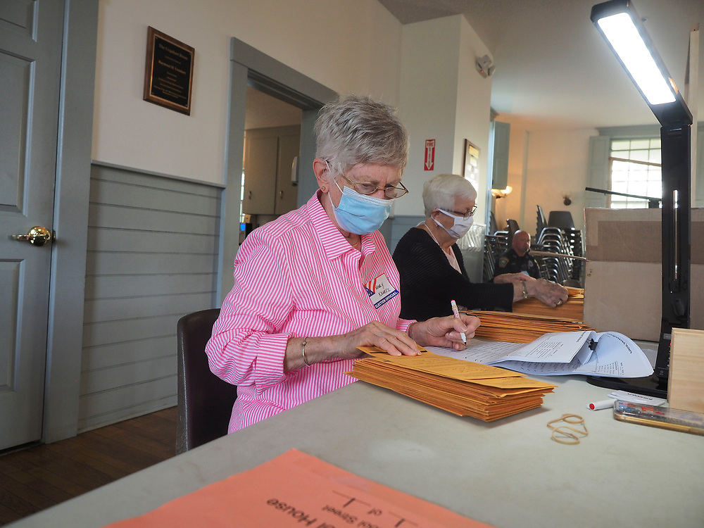 Poll workers in Dennisport opened and processed early voting ballots. Throughout the Commonwealth, Massachusetts voters cast absentee ballots and early vote ballots in record numbers.