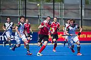 Holcombe's Gareth Andrews chases the ball. Holcombe v Surbiton - Semi-Final - Men's Hockey League Finals, Lee Valley Hockey & Tennis Centre, London, UK on 22 April 2017. Photo: Simon Parker