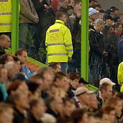 NLD/Arnhem/20051211 - Voetbal, Vitesse - Ajax 2005, Ajax supporters achter plastic schotten in hun supportervak