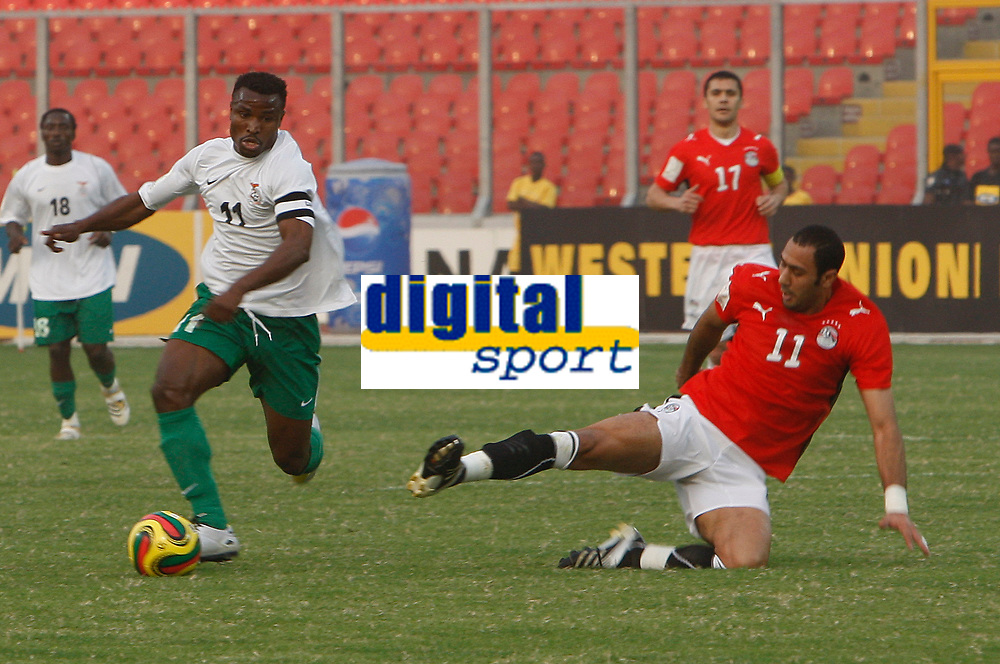 Photo: Steve Bond/Richard Lane Photography.<br />Egypt v Zambia. Africa Cup of Nations. 30/01/2008. Mohamed Shawky (R) incoming on Christopher Katongo (L)