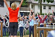 Nederland, Ooij, 14-7-2017Oud atlete Olga Commandeur opende met de Ooijse bevolking de beweegtuin. Commandeur presenteert een programma met ochtengymnastiek op de radio en geeft door het hele land bewegingsworkshop, vooral gericht op ouderen.Foto: Flip Franssen