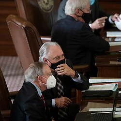 Austin, TX USA March 31, 2021:  State Rep. Drew Darby, R-San Angelo, (c) on the floor of the Texas House of Representatives during routine bill readings at the 87th Texas legislative session. Emergency bills include power company regulation, border security and the coronavirus response.