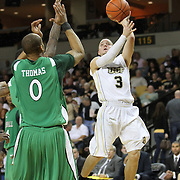 Central Florida guard A.J. Rompza (3) shoots over Marshall forward Johnny Thomas (0) during a Conference USA NCAA basketball game between the Marshall Thundering Herd and the Central Florida Knights at the UCF Arena on January 5, 2011 in Orlando, Florida. Central Florida won the game 65-58 and extended their record to 14-0.  (AP Photo/Alex Menendez)