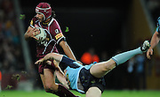 May 25th 2011: Johnathan Thurston of the Maroons fends off the Blues defence during game 1 of the 2011 State of Origin series at Suncorp Stadium in Brisbane, Australia on May 25, 2011. Photo by Matt Roberts/mattrIMAGES.com.au / QRL