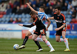 Huddersfield Town's Nahki Wells competes with Fulham's Ryan Tunnicliffe - Photo mandatory by-line: Richard Martin-Roberts/JMP - Mobile: 07966 386802 - 21/03/2015 - SPORT - Football - Huddersfield - John Smith's Stadium - Huddersfield Town v Fulham - Sky Bet Championship