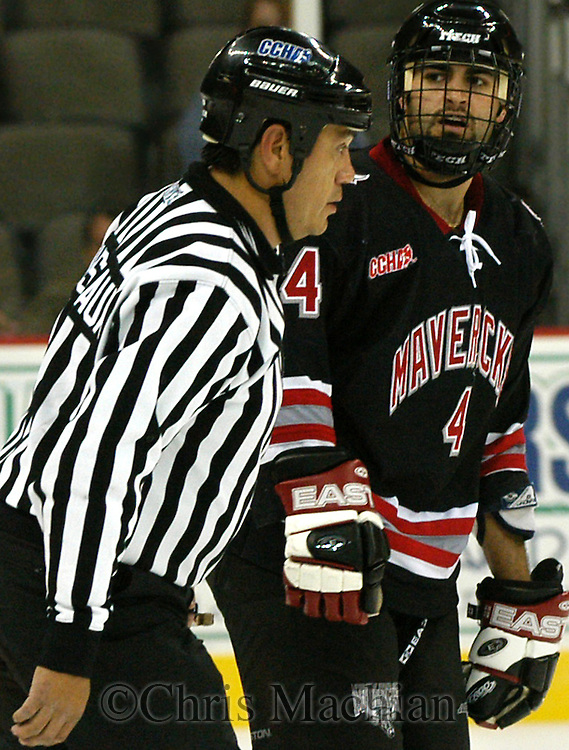 CM-11/8/03-Omaha, NE   University of Nebraska at Omaha's Chris Claffey argues with  linesman Butsch Mousseaux a  during Saturday night's game at the Omaha Convention Center. Claffey was called for roughing with 1:32 left int he first period. (Photo by Chris Machian,Prairie Pixel Group