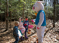 Ian, Vivian and Evelyn were greeted by the Easter Bunny on Gilford's Nature Trail during the Egg Hunt and Story Walk on Saturday morning.  (Karen Bobotas Photo/for The Laconia Daily Sun)