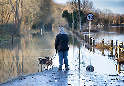 © Licensed to London News Pictures. 23/12/2019. Yalding, UK. A resident looks at the flooding at Yalding in Kent after flood levels began to recede from the centre of the village. River levels are beginning to drop after days of heavy rain in the south. Photo credit: Peter Macdiarmid/LNP